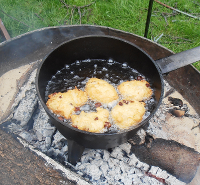 Cooking fritters on an open fire